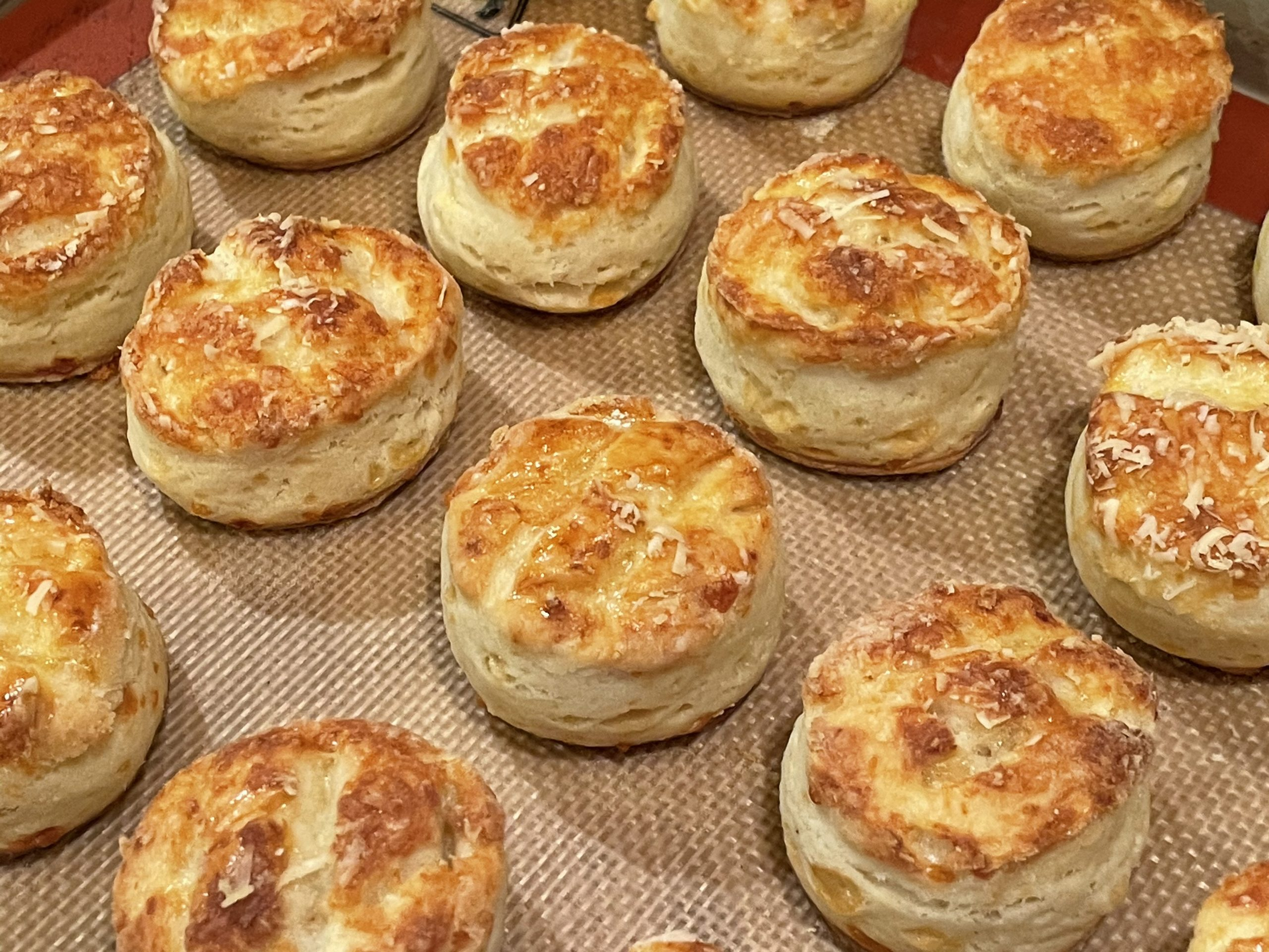 Cheese biscuits on baking sheet. Greg Patent
