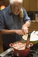 Photo of Greg Patent frying dough